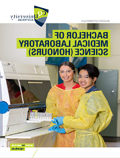 Students wearing laboratory clothing in a research laboratory