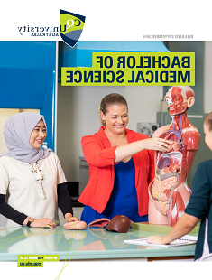 Students with a mannequin of the human body and its organs